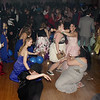 """Anderson High School prom-goers """"get low"""" while dancing in the Paramount Ballroom on Saturday evening. (Mark Maynard photo)"""