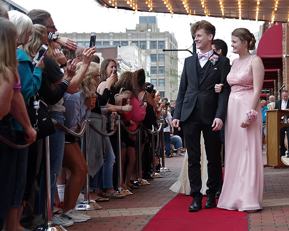 Mark Maynard | for The Herald Bulletin<br /> Posing for photos on the Red Carpet on the way into the Anderson High School Prom at the Paramount Theatre.