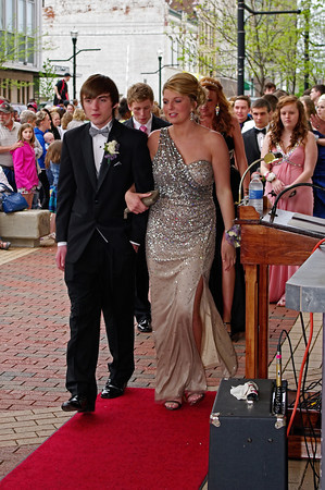 """Marcie Cox and Anthony Beane walk the red carpet to the Alexandria High School """"Greatest Show on Earth"""" prom."""