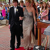 "Marcie Cox and Anthony Beane walk the red carpet to the Alexandria High School ""Greatest Show on Earth"" prom."