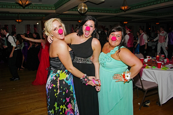 """LIndsey Hope, Maddison Hoke and Kyra Waters get into the spirit of the Alexandria High School """"Greatest Show on Earth"""" prom theme by donning clown noses."""