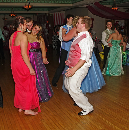 """Alexandria High School """"Greatest Show on Earth"""" prom attendees dancing."""