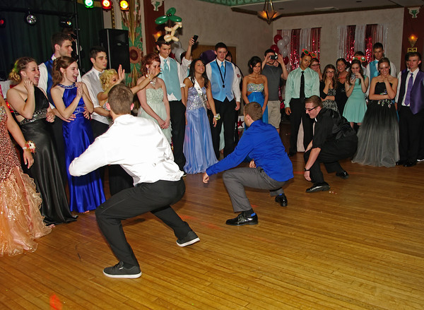"""Senior class boys perform a special dance routine to the delight of the crowd at the Alexandria High School """"Greatest Show on Earth"""" prom."""