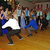 "Senior class boys perform a special dance routine to the delight of the crowd at the Alexandria High School ""Greatest Show on Earth"" prom."