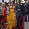 Walking the red carpet to the Anderson High School Prom are Jacie Dickerson and Alvin McClendon.