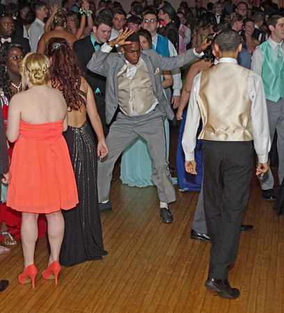 Ishmeal Allensworth shows off his dance moves during the Anderson High School Prom on Saturday night.