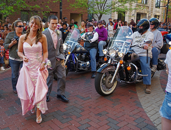 Emily Short and Michael Fetters arrive at the Paramount Theatre accompanied by a motorcycle escort for the Anderson High School Prom on Saturday night.
