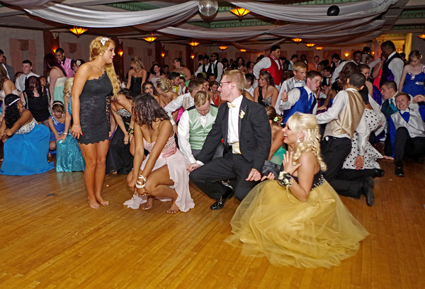 """Dancers """"get low"""" at the Anderson High School Prom."""