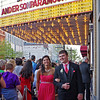 Paulina Berger and Weston Bell stroll past well-wishers on their way into the Paramount Theatre for the Anderson High School Prom.
