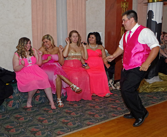 """Andrew DiMaggio entertains Sarah Harris, Tia Daugherty, Candice Covington and Destiny Hill with his dancing during the Anderson High School """"Great Gatsby"""" Prom Saturday evening at the Paramount Theatre."""