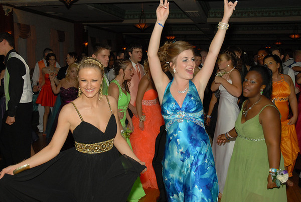 Haley Weston and Erika Smith dance at the prom.