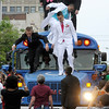 Students arrive at the Anderson High School prom at the Paramount riding on top of a bus on Saturday.