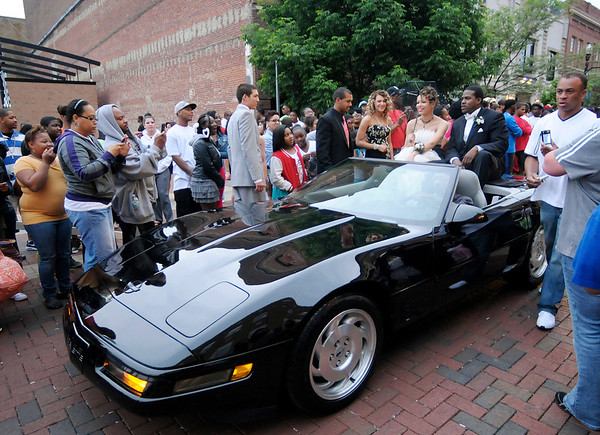Tyquann Swift and his date Kelsey Goodwin arrive at the Anderson High School prom at the Paramount in a '95 Corvette driven by Steve Willis on Saturday.