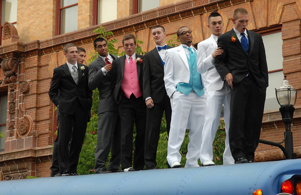 Arriving at the prom atop a school bus.