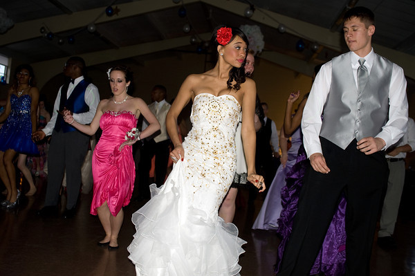 Cameron Harris, a junior, and Denise Bradley, a senior, enjoy themselves on the dance floor during the Anderson Preparatory Academy Prom held Saturday May 4 at the MillCreek Center in Chesterfield. Both are prom court nominees. Photo by Richard Sitler