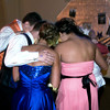 Students huddle together to look at a video on a smart phone. The Anderson Preparatory Academy Prom was held Saturday May 4 at the MillCreek Civic Center in Chesterfield. Photo by Richard Sitler