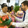 Malquesha Murphy Hopkins is given flowers after being crowned Queen of the Anderson Preparatory Academy Prom held Saturday May 4 at the MillCreek Center in Chesterfield. Photo by Richard Sitler