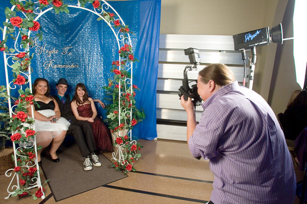 Tijera Wilson, Tyler Gross and Styrling Brown, all juniors, pose for a picture taken by Lifetouch photographer Sonja Berryhill. The Anderson Preparatory Academy Prom was held Saturday May 4 at the MillCreek Civic Center in Chesterfield. Photo by Richard Sitler