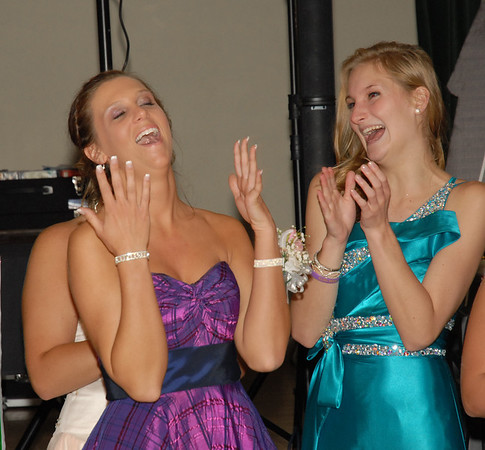 Ellie Fettig (left) reacts after being named 2012 Prom Queen.