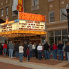 A crowd gathers outside the Paramount Theatre to watch festivities on the red carpet.