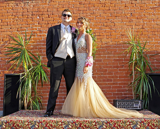 John Deckard and Shelby Reese pose for family and friends to snap photos before the Elwood High School Prom at the Opera House on Saturday evening.