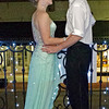 """Meredith Helpling and Brandon Leisure take a moment during the Elwood HIgh School """"Enchanted Garden"""" Prom to enjoy the cool breeze on the Opera House balcony."""