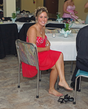 Alexys Rostetter takes a break from dancing at the Frankton High School Prom on Saturday night.