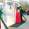 "Taylor Creech and Jayln Summers sign the story book wall prior to Frankton High School's ""Once Upon a Time"" Prom."
