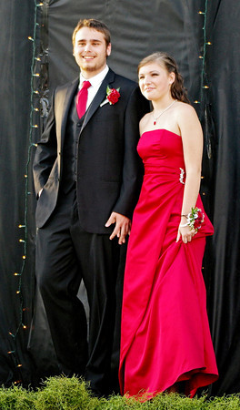 Brian Hendricks and Julie Whitaker pose for photographs while crossing the red carpet to enter the Frankton High School Prom Saturday night at The Factory.