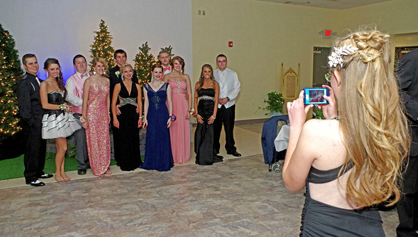 """Sydney Wagoner snaps a photo of some friends during the """"Once Upon a Time"""" Frankton High School Prom."""