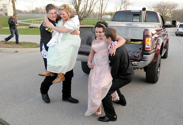 From left Austin Baker and Preston Seybert help their dates Shelby West and Reagan Finley out of the back of a truck as they arrive at Lapel's prom on Saturday.