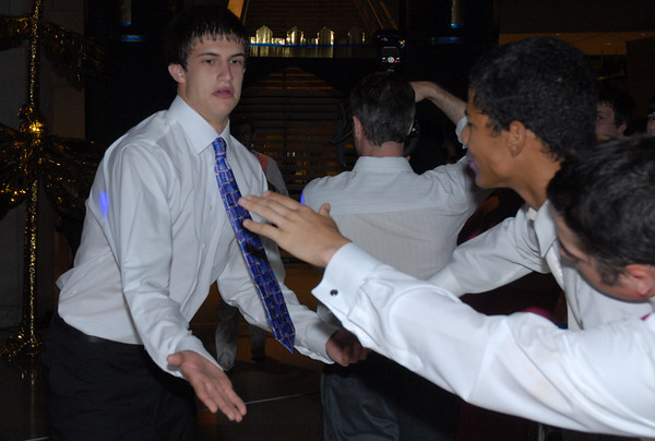 Prom King candidate Kellen Dunham is greeted with high fives after his introduction.