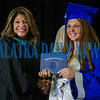 Elivia Gutierrez receives her diploma from principal Mary Wood. Fran Ruchalski/Palatka Daily News