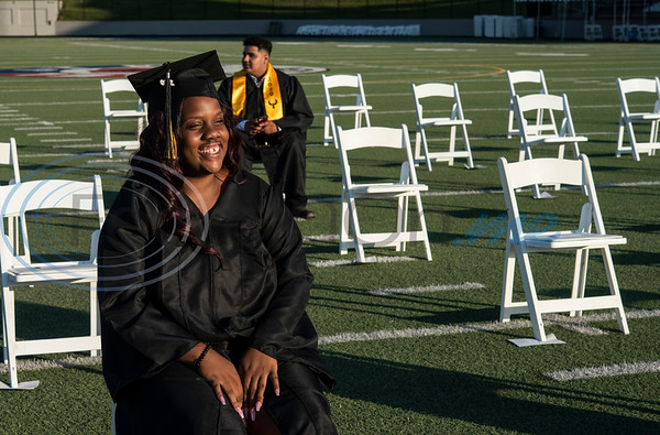 RISE Academy graduate Alecia Campbell smiles as she waits to receive her diploma at Christus Trinity Mother Frances Rose Stadium on Wednesday, June 3, 2020.