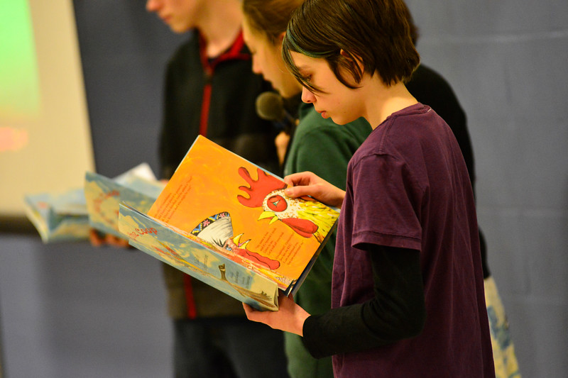 "KRISTOPHER RADDER - BRATTLEBORO REFORMER<br /> A small group of middle schoolers from Putney Central School reads ""Ralph Flies the Coop"" to the younger students on Friday, March 17, 2017."