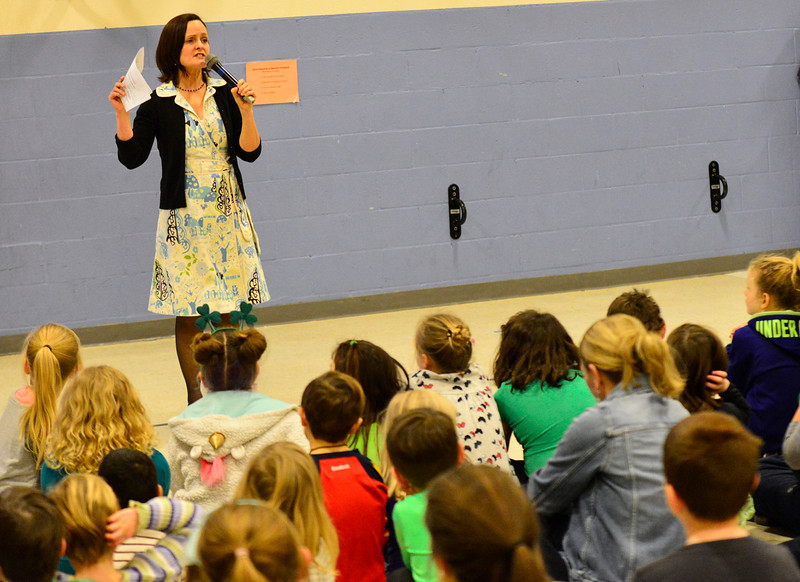 """KRISTOPHER RADDER - BRATTLEBORO REFORMER<br /> Jamie Scanlon, author of """"Ralph Flies the Coop,""""  asks a group of students at Putney Central School how to say hello in different languages on Friday, March 17, 2017."""