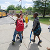 Students board the buses at Reingold Elementary after being released from the last day of school on Wednesday afternoon. SENTINEL & ENTERPRISE / Ashley Green