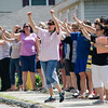 Teachers wave goodbye to students at Reingold Elementary after being released from the last day of school on Wednesday afternoon. SENTINEL & ENTERPRISE / Ashley Green