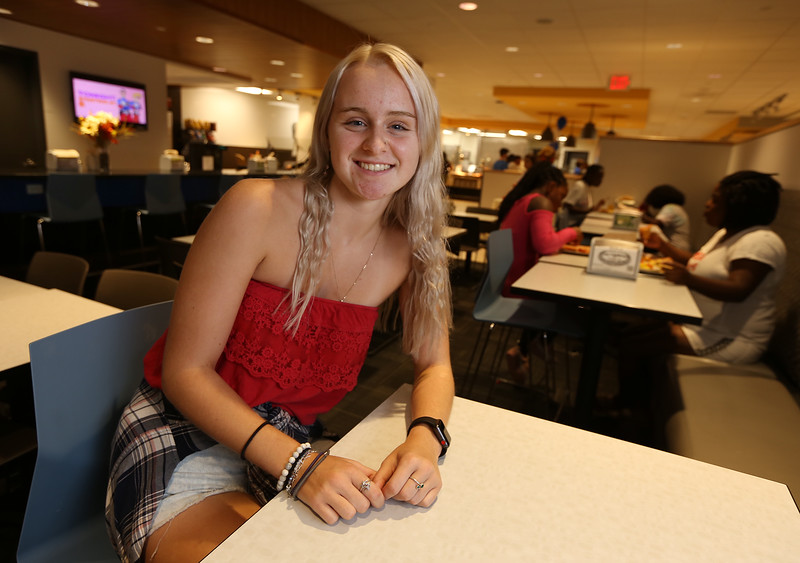 Brianna Langlois, 19, of Westford, in the cafeteria at ICC, is in UML and MCC's Reserve Placement Progam, spending her first semester at MCC but living at the ICC dorm before becoming a UML student second semester. (SUN/Julia Malakie)