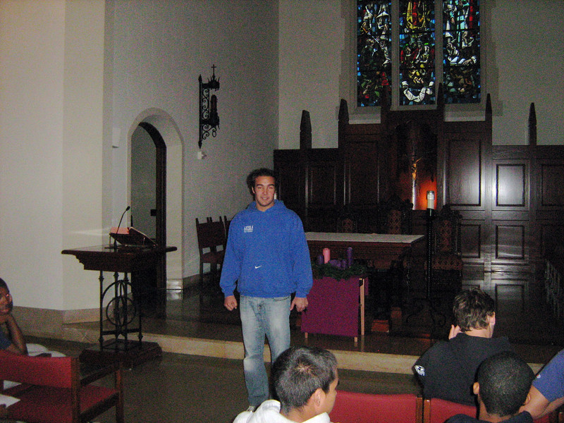 Mr. Matt Schaeffer, Director of Campus Ministry, welcomes the retreatants to the prayer service in the chapel, Thursday, December 1, 2011