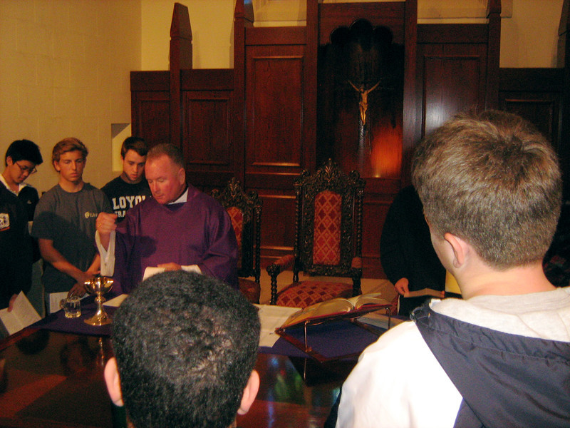 Fr. Barber, S.J. during the Eucharist
