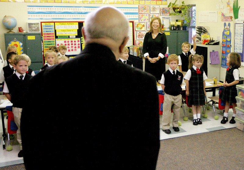 E.L. Hubbard Photography<br /> Archbishop Daniel Pilarczyk visits classrooms after the Mass of Thanksgiving at the school Friday, September 25, 2009.