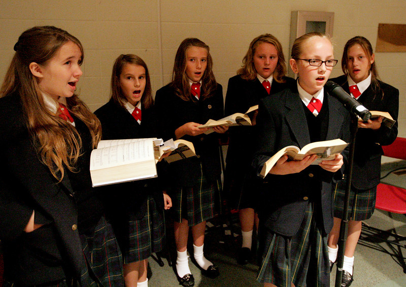E.L. Hubbard Photography<br /> The student choir sings during the Mass of Thanksgiving at Royalmont Academy in Mason Friday, September 25, 2009.