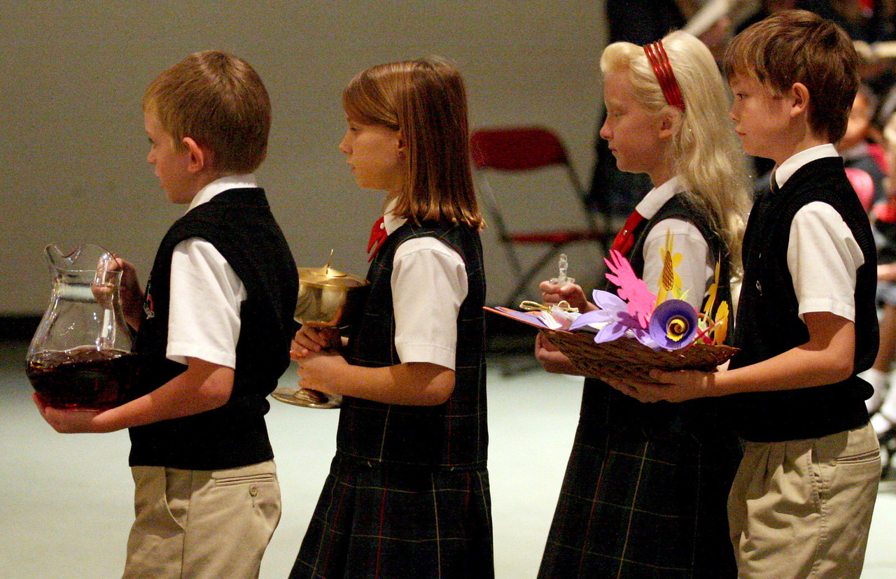E.L. Hubbard Photography<br /> Students bring the gifts during the Mass of Thanksgiving at Royalmont Academy in Mason Friday, September 25, 2009.