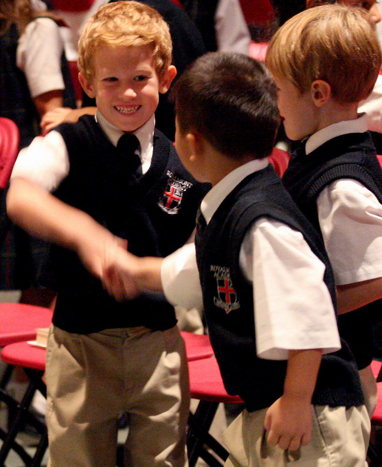 E.L. Hubbard Photography<br /> Students greet each other during the Mass of Thanksgiving at Royalmont Academy in Mason Friday, September 25, 2009.