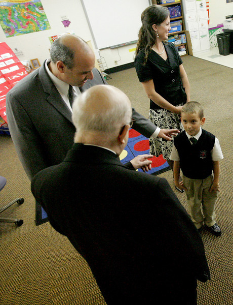 E.L. Hubbard Photography<br /> Archbishop Daniel Pilarczyk is introduced to student John Ferraro, 5, by his father, Royalmont Academy Executive Director Tony Ferraro, while visiting the classroom of Emily Mersch after the Mass of Thanksgiving at the school Friday, September 25, 2009.