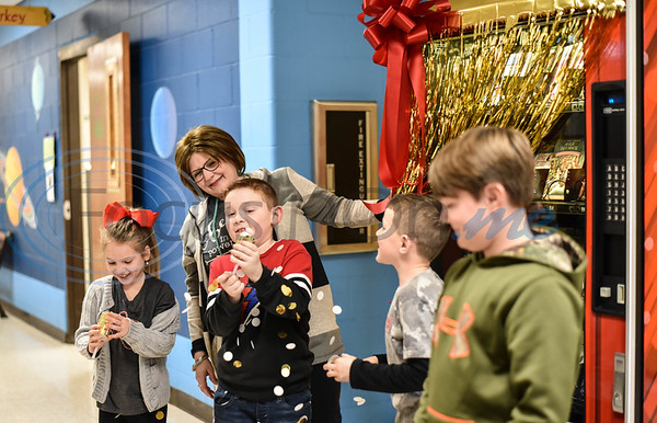 Rusk Elementary students celebrate the unveiling of the school's new book vending machine on Thursday, January 30. Students will be rewarded with a token to pick a book from the machine for good behavior, acts of kindness and other positive actions. (Jessica T. Payne/Tyler Morning Telegraph)