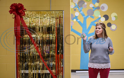 Rusk Elementary School assistant principal Ashley Oliver-Clayton prepares to hand over scissors for the Ribbon Cutting of the school's new book vending machine on Thursday, January 30. The machine was installed as part of a special student incentive program. (Jessica T. Payne/Tyler Morning Telegraph)