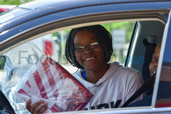 Rusk senior Jamyah Anderson smiles while holding her cap and gown on pick up day, Tuesday, April 14. Parents and students were told to remain in the car due to the current Coronavirus pandemic. Seniors were set to graduate on May 22 but are bracing for the possibility of a non-traditional ceremony.