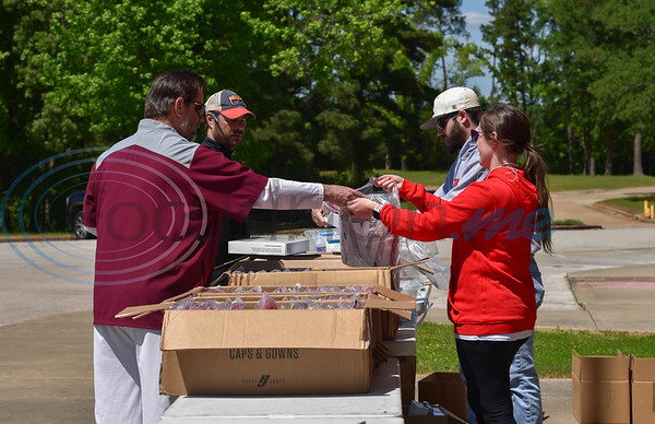 A handful of Rusk High School staff gathered on campus to hand out senior cap and gowns on Tuesday, April 14. At a time when students were supposed to gather in excited anticipation of their final day in high school, they were instructed not to get out of their cars due to current Coronavirus pandemic.